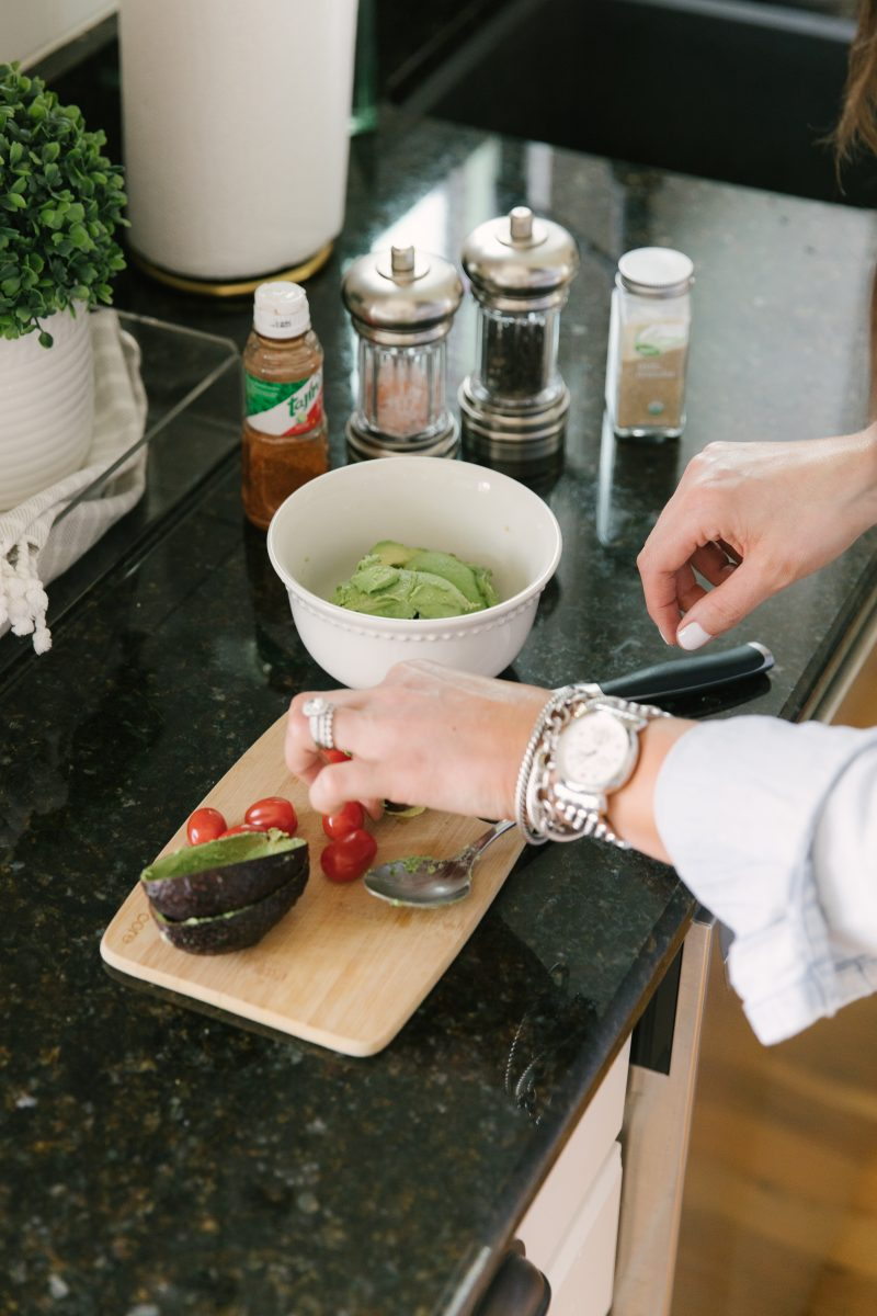 Image of hands preparing guacamole