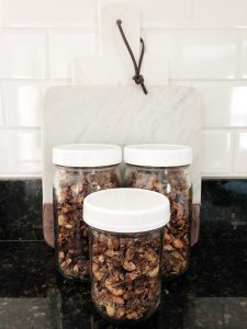 Image of three jars with toasted coconut granola