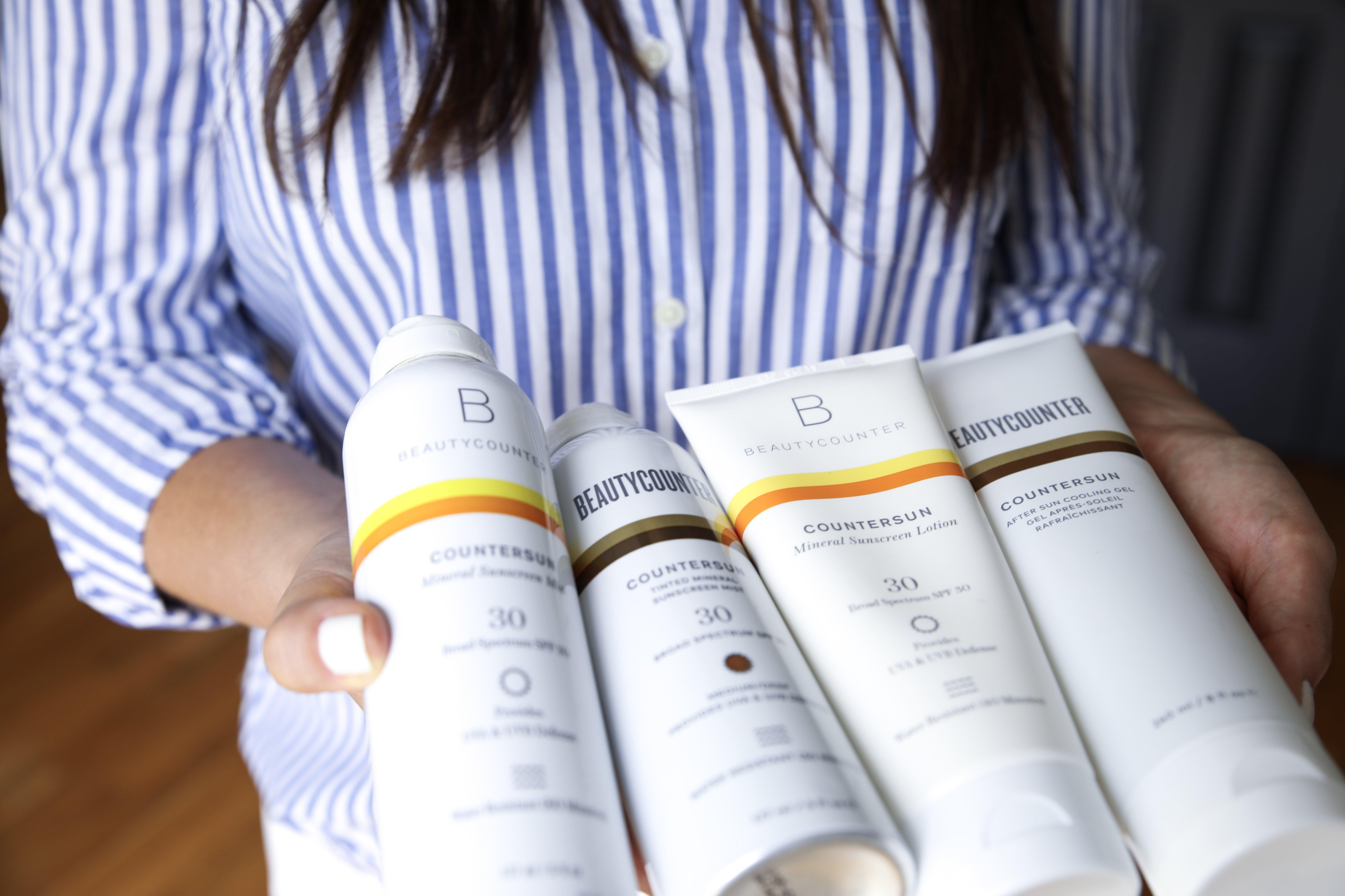 Image of sarah bridgeman holding sunscreen